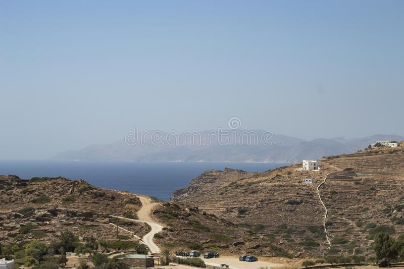 Greece, Ios. A parched, dry landscape. Greece, the island of Ios. A parched, dry landscape in late summer. Hills and fields. In the distance, the blue Aegean stock image