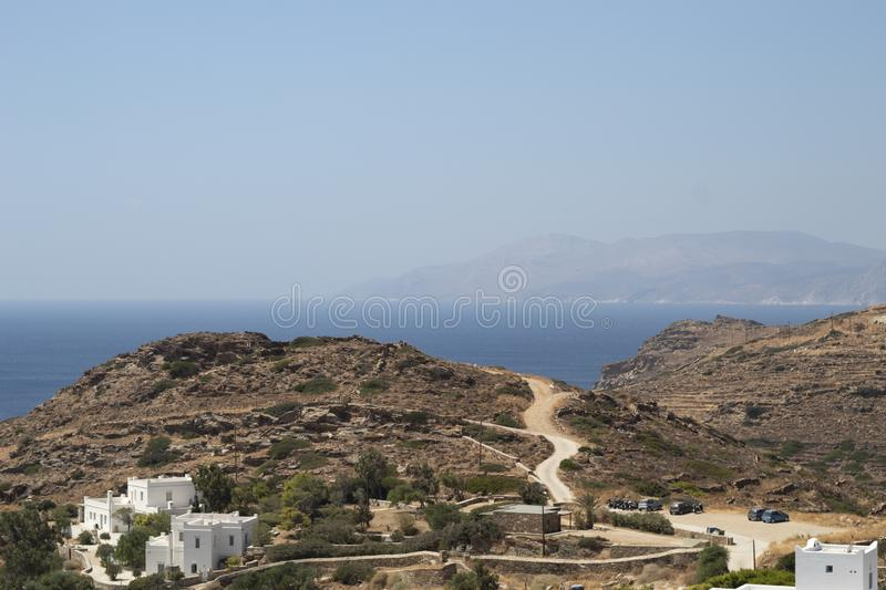 Greece, Ios. A parched, dry landscape. Late summer. Greece, the island of Ios. A parched, dry landscape in late summer. Hills and fields. In the far distance is stock images