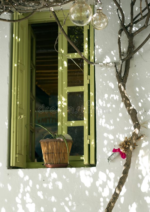 Greece, Folegandros. A shaded corner with window and vine. Greece the island of Folegandros. A quiet corner in the old capital, the Hora. A vine frames the royalty free stock images