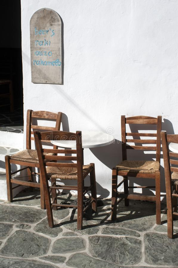 Greece, Folegandros.  Three chairs at a cafe. Greece, the island of Folegandros.  Three chairs on a terrace at an old fashioned cafe in the islands capital, the royalty free stock photos