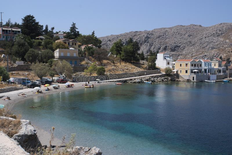 Greece, Symi, Emborio. Placid waters on a summers day. stock photo