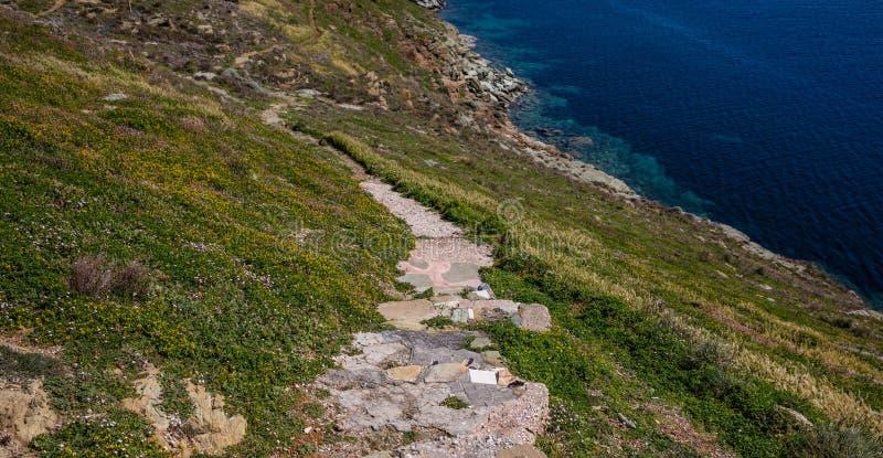 Greece. Kea island. Pathway, landscape in springtime and blue sea water. Greece. Kea island. Pathway on the clif, landscape in springtime and blue sea water stock images