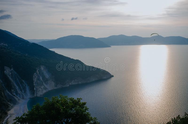 Greece - Kefalonia - Myrtos Beach sunset. Kefalonia is the largest of the Ionian Islands in western Greece and the 6th largest island in Greece, Myrtos beach is royalty free stock image