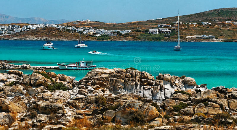 Greece, Paros. Panoramic view of boats sailing off Kolimbithres beach with resort in the background, Paros Island, Greece