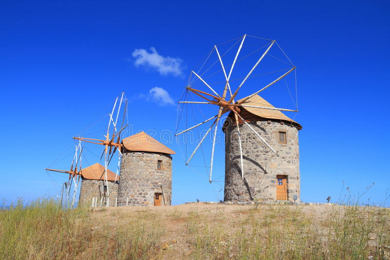 Greece/Patmos: The mills of Chora. These historic windmills in Chora/Patmos have been restored. The mills are equipped with jib sails, which are simple triangles royalty free stock photography
