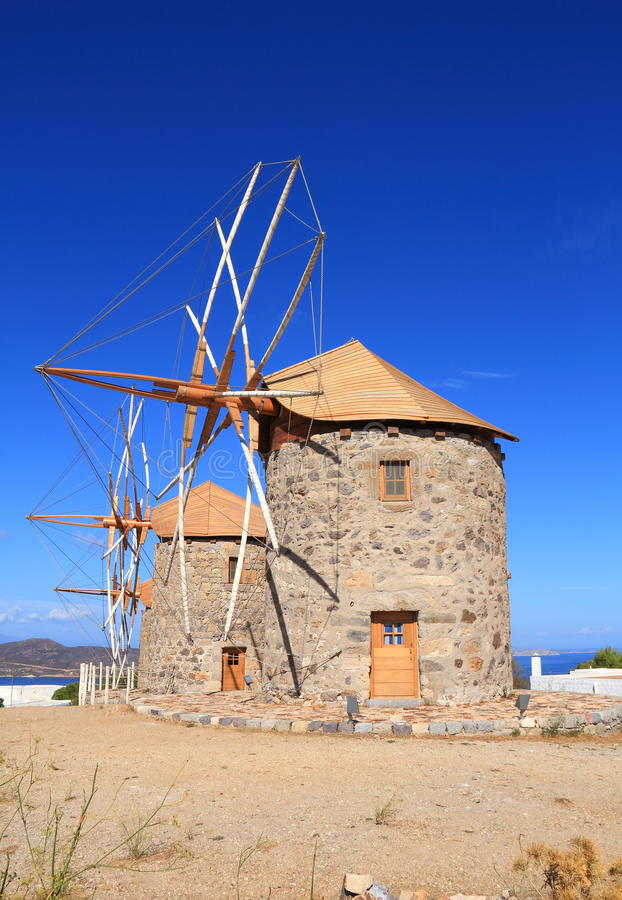 Greece/Patmos: The Mills of Chora. These historic windmills in Chora/Patmos have been restored. The mills are equipped with jib sails, which are simple triangles stock photo