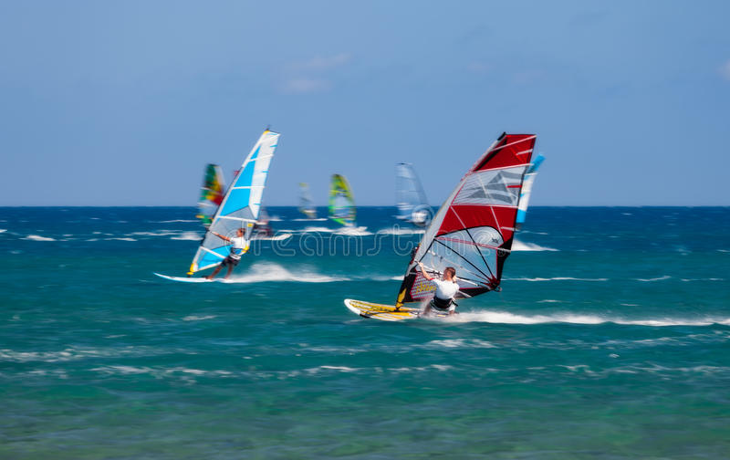 Greece, Rhodes - July 16 Windsurfers on Prasonisi on July 16, 2014 in Rhodes, Greece. Prasonisi confluence of the Aegean and Mediterranean seas. The place for royalty free stock image