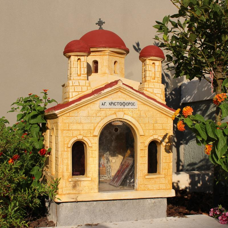 A small road church in Crete. In Greece, small chapels are built at the roadside to honor someone who lost their live on the road stock photos