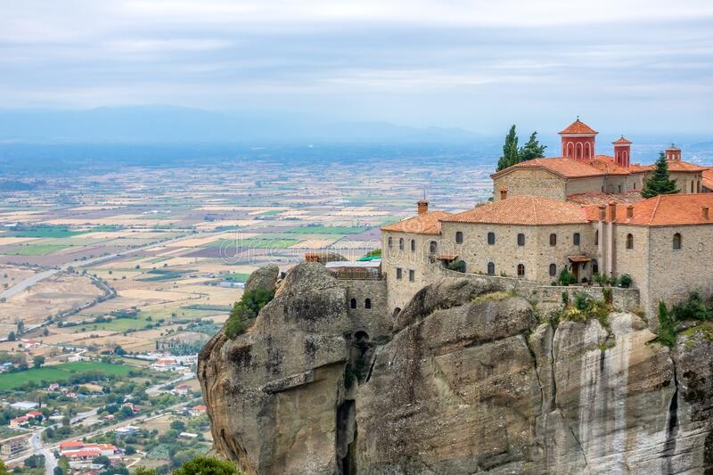 Monastery on a High Cliff Above the Town and Fields royalty free stock photo