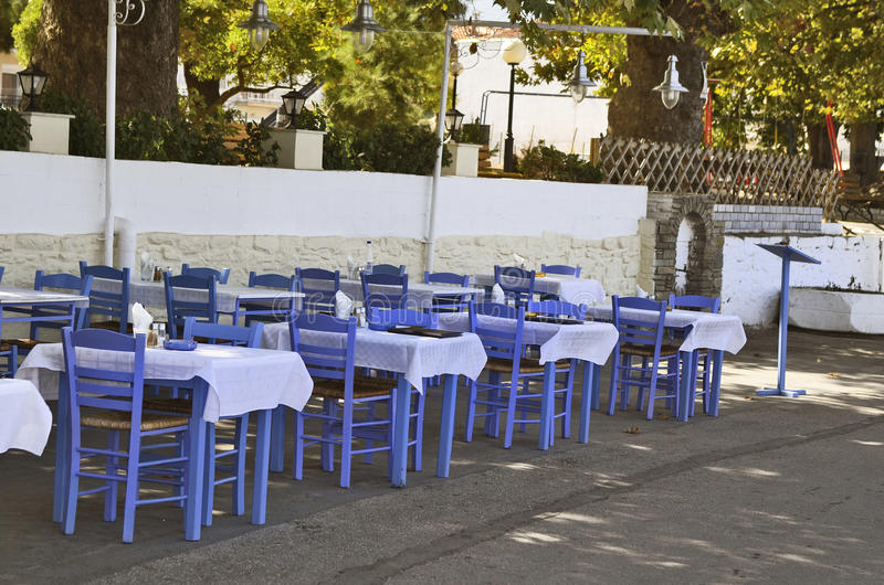 Greece, Thassos. Greece, restaurant with blue tables and chairs in Thassos royalty free stock images