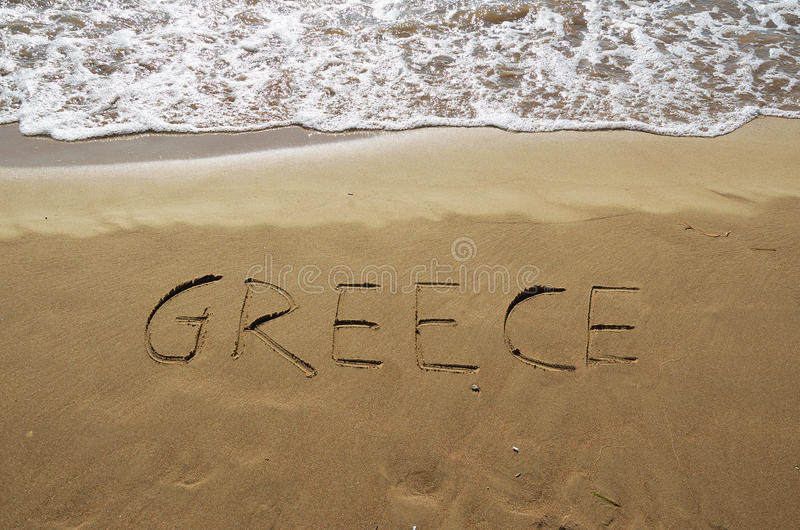 Greece written in sand stock photography