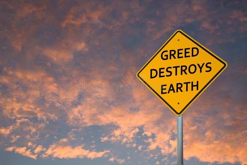 'GREED DESTROYS EARTH', gelbes Straßenschild lizenzfreie stockbilder