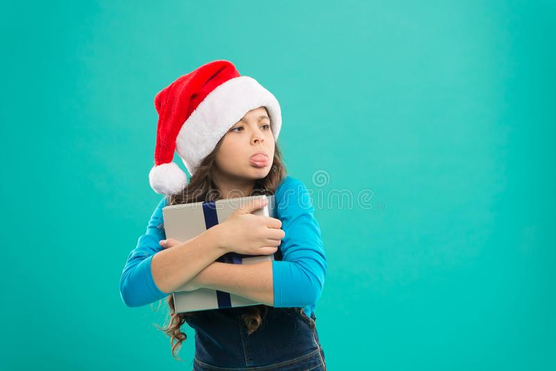 Greedy baby hold package tight. I will not give it to anyone. Shopping online. Winter sale. Child hug gift. Happy new. Year. All about sharing and caring royalty free stock photo