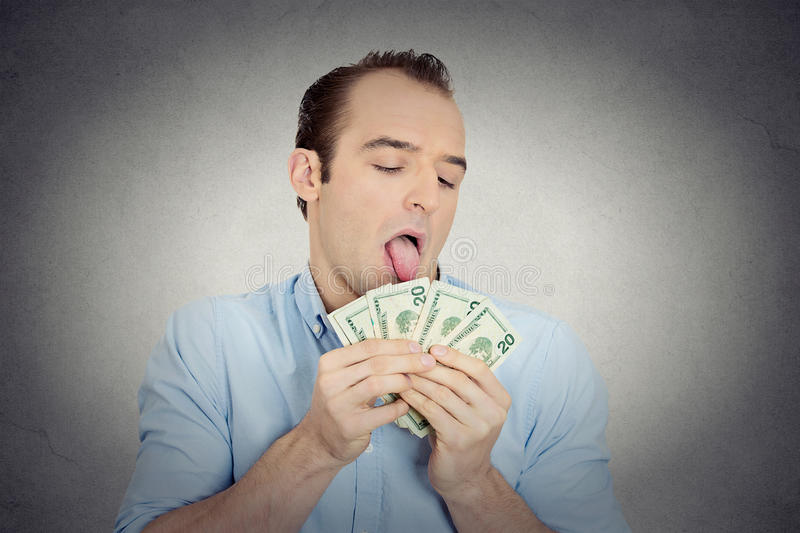 Greedy banker, CEO boss, corporate employee obsessed with money. Closeup portrait greedy banker, CEO boss, corporate employee, crazy guy, funny looking man royalty free stock image