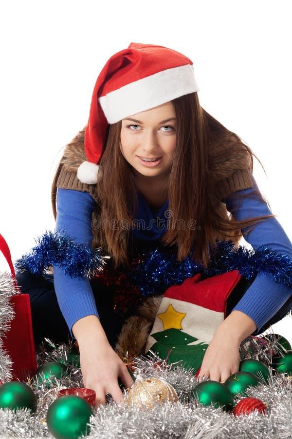 Greedy dwarf. Greedy girl in Santa cap stock photos