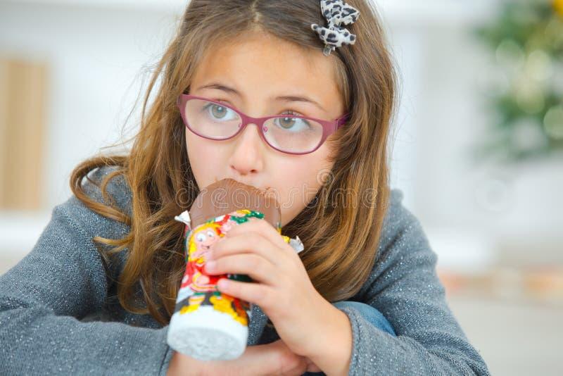 Greedy little girl eating chocolate stock photos