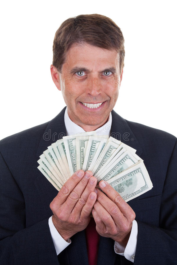 Greedy Man in a Suit. Greedy business man admiring his 20 and 100 dollar bills stock image