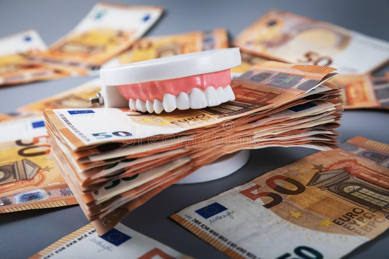 Greedy people and materialism concept. Mouth full of money royalty free stock photo