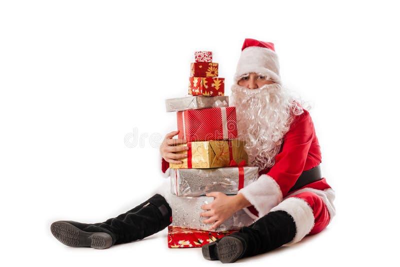 Greedy Santa Claus. And gifts pyramid royalty free stock images