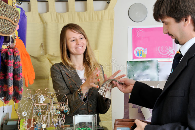 Download Greedy Smiling Pretty Seller Stock Photo - Image: 6810720