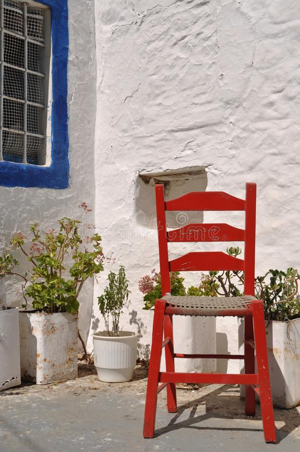 Greek chair. Traditional greek house with red chair in Zia village (Kos), Greece stock images