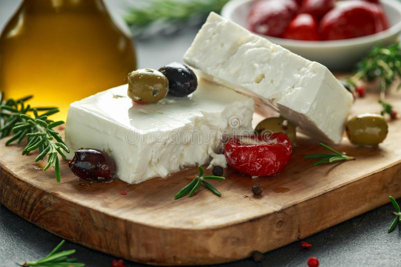 Greek cheese feta with thyme, rosemary, olives and stuffed red bell peppers.  royalty free stock photo