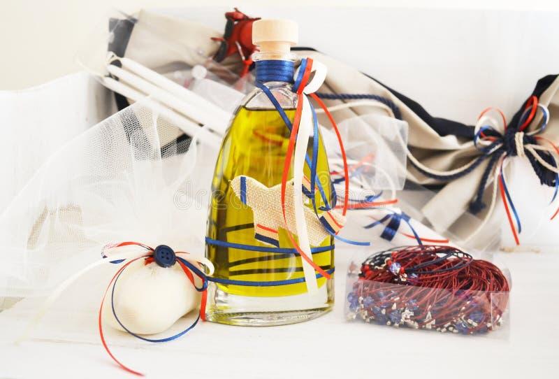 Greek Christening oil, soap, candles and baptism bracelets stock images