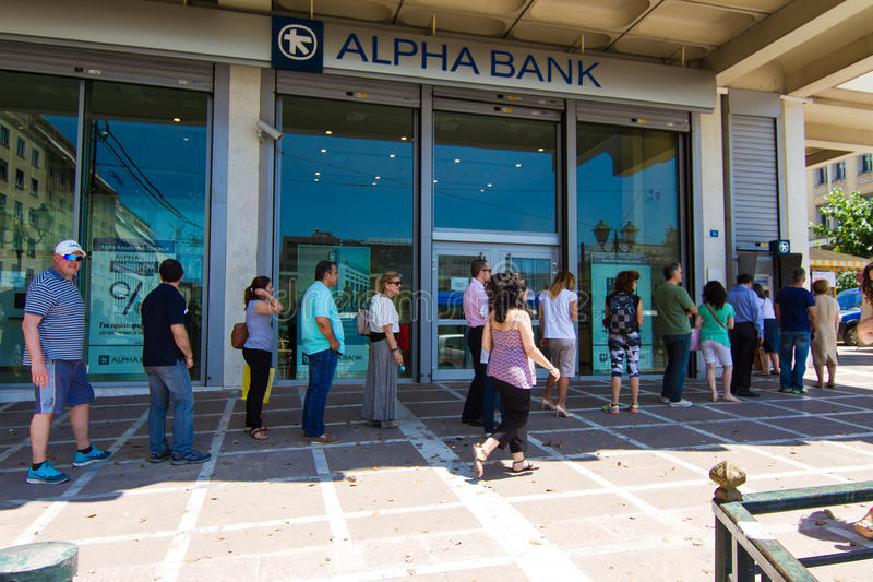 Greek citizens line up at an ATM. ATHENS, GREECE - JULY 7TH, 2015: Citizens line up to use an ATM outside the Alpha Bank, on July 7th, 2015, in Athens, Greece stock photos