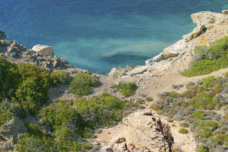 Greek coastline on island Telendos, blue ocean and green plants. royalty free stock photography