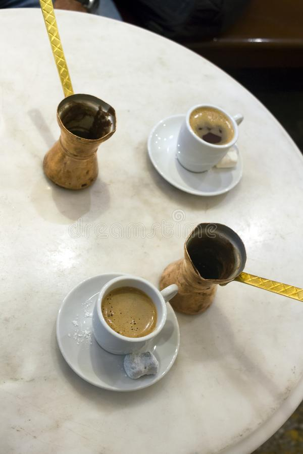 Greek coffee and sweet loukoumi served with brass coffe pots. Taken in Athens royalty free stock image