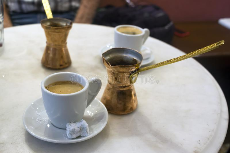 Traditional greek coffee served with brass pot and sweet loukoumi. Taken in Athens stock images