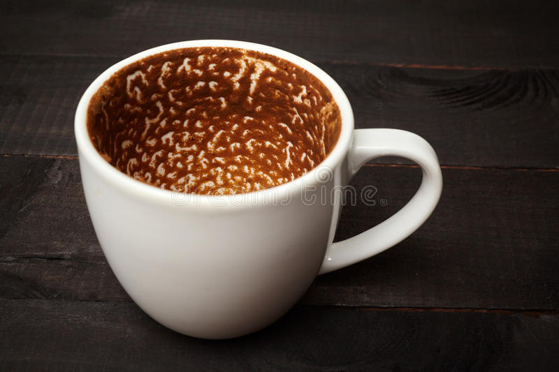 Greek coffee cup. Finished Greek coffee cup on black royalty free stock photo