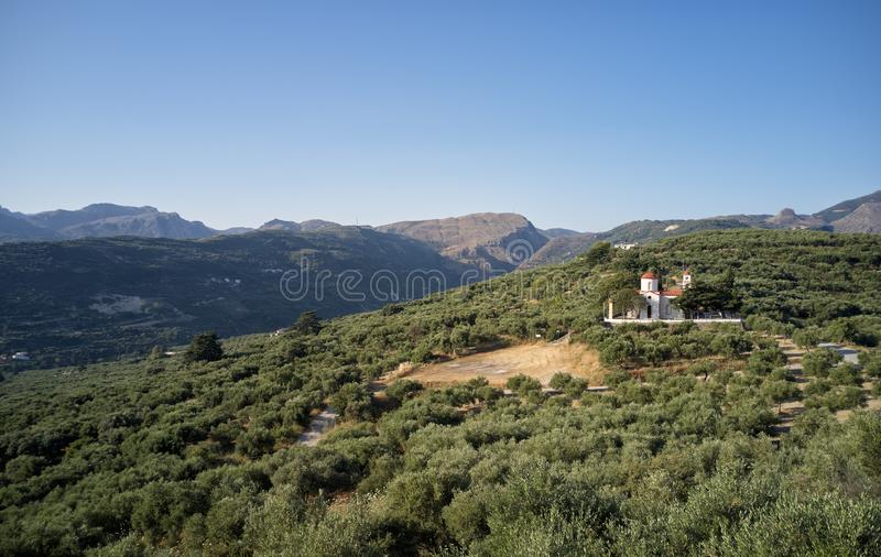 Greek countryside bird's-eye view from drone. Church  on  hill  surrounded by olive groves stock images