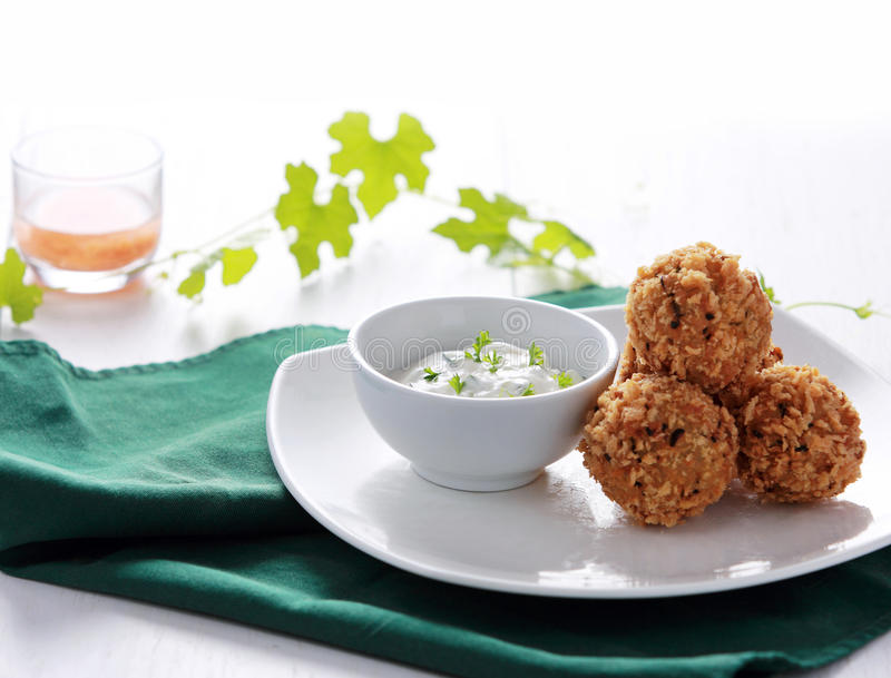 Greek cuisine fried crispy zucchini and feta balls stock images