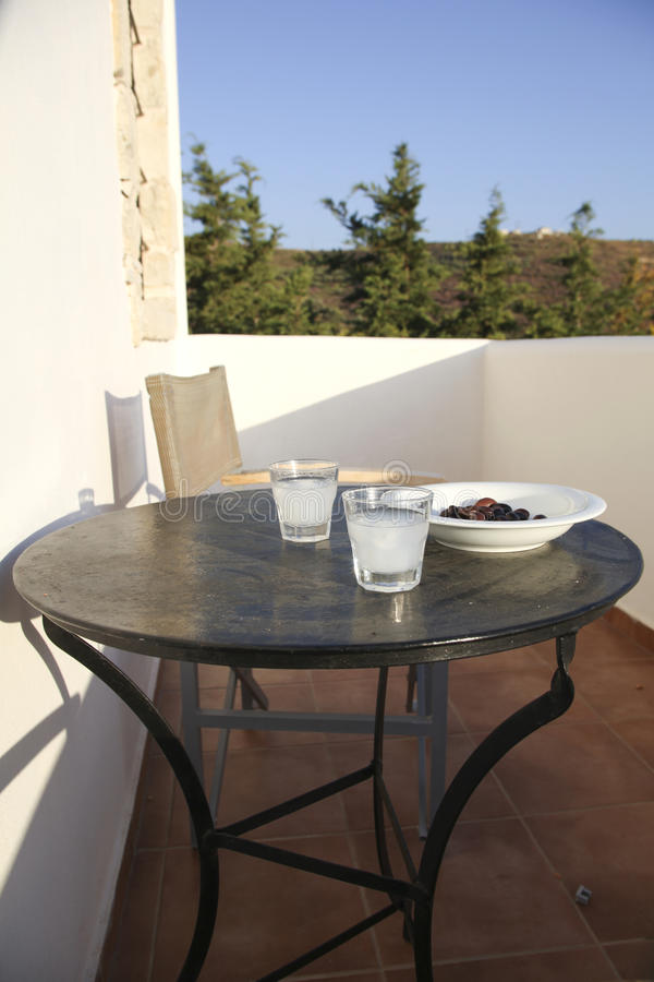 Greek diet. Two glasses of ouzo on a balcony stock images
