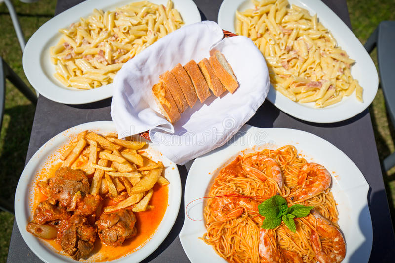 Download Greek dishes on table stock image. Image of greek, fries - 93602363