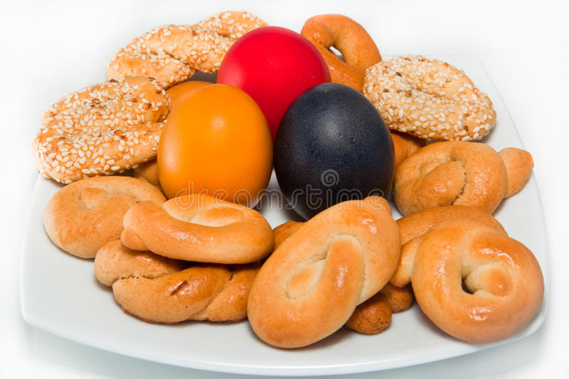 Greek Easter Eggs and Biscuits. Traditional Greek Easter eggs with homemade Greek biscuits stock photo