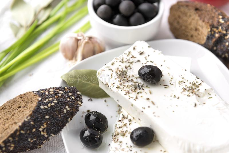 Greek feta cheese, bread, olives,. Greek feta cheese, olives, bread, spices, Greek feta cheese, olives, bread, spices royalty free stock photo