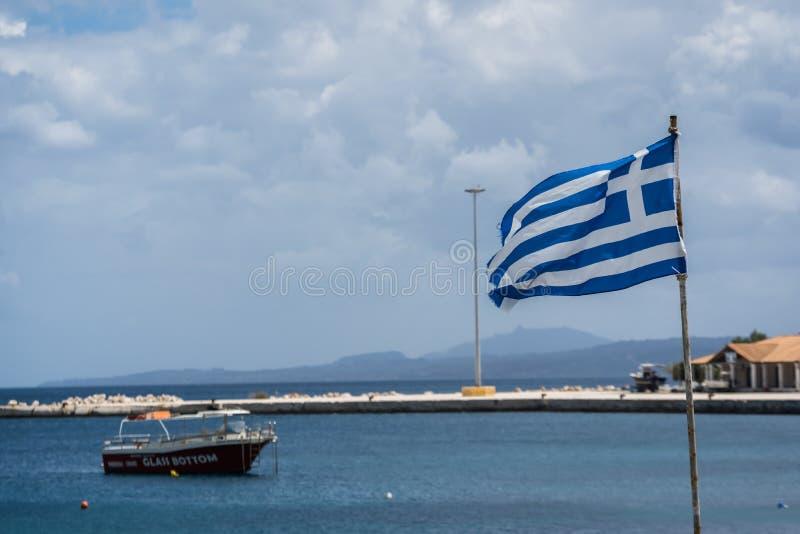 Greek flag in Agios Nikolaos port stock images