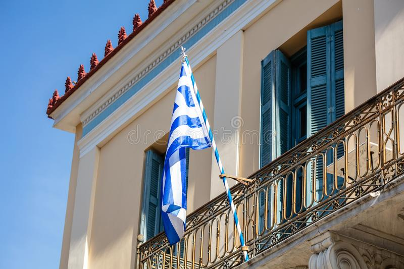 Greek flag on a balcony of a neoclassical house, Ahens, Plaka royalty free stock images