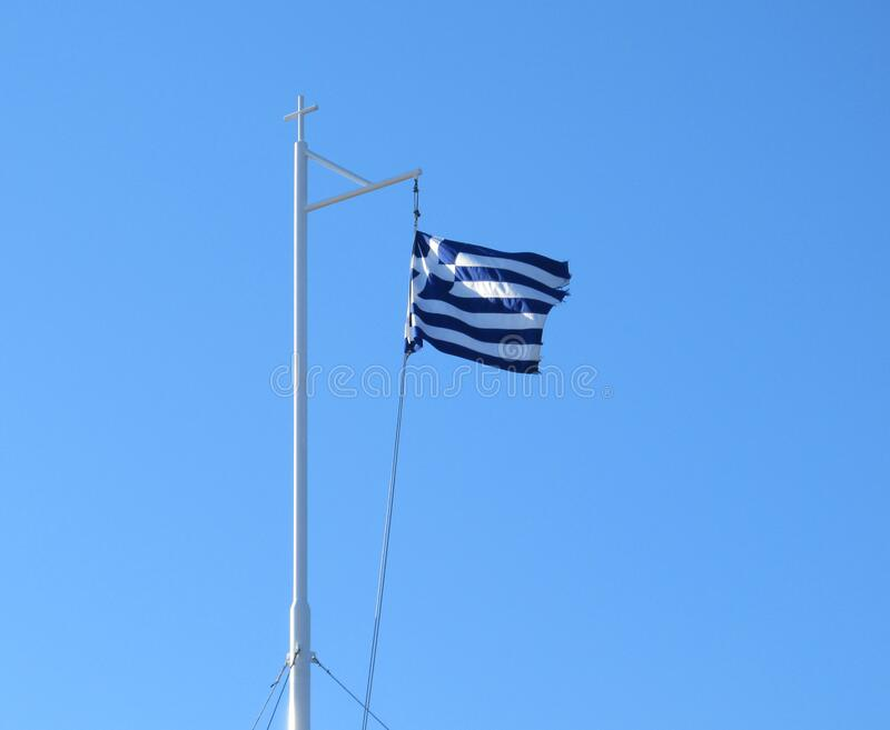 Greek Flag in the Blu Sky.  stock photography