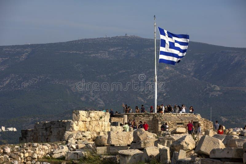 Greek flag on blue sky background. Acropolis, Athens, Greece. A gigantic Greek flag on the Athenian Acropolis. The national flag stock photography