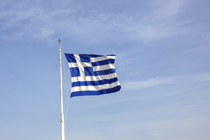 Greek flag on blue sky background. Acropolis, Athens, Greece. A gigantic Greek flag on the Athenian Acropolis. The national flag stock image