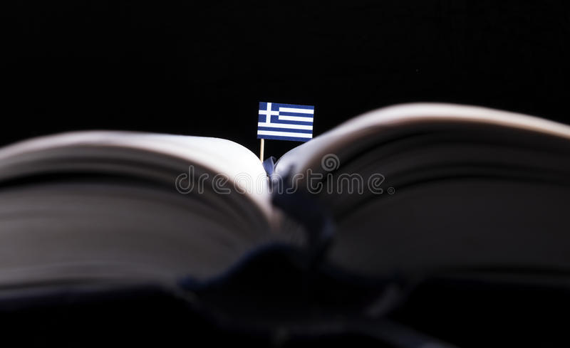 Greek flag in the middle of the book. stock image