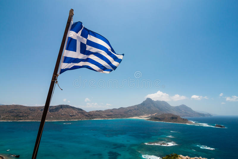 Greek flag over sea stock images