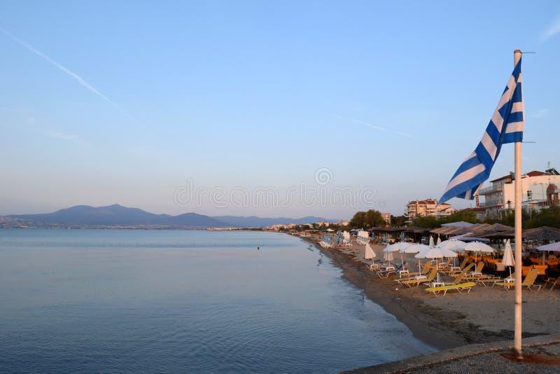 Thessaloniki, Greece - September 1 2017: View of Agia Triada suburb in Thessaloniki, sea and greek flag waving. royalty free stock photos