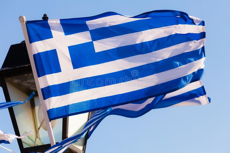 Greek flags waving outdoor. On strings during summer weather. Greece European country national landmark royalty free stock image