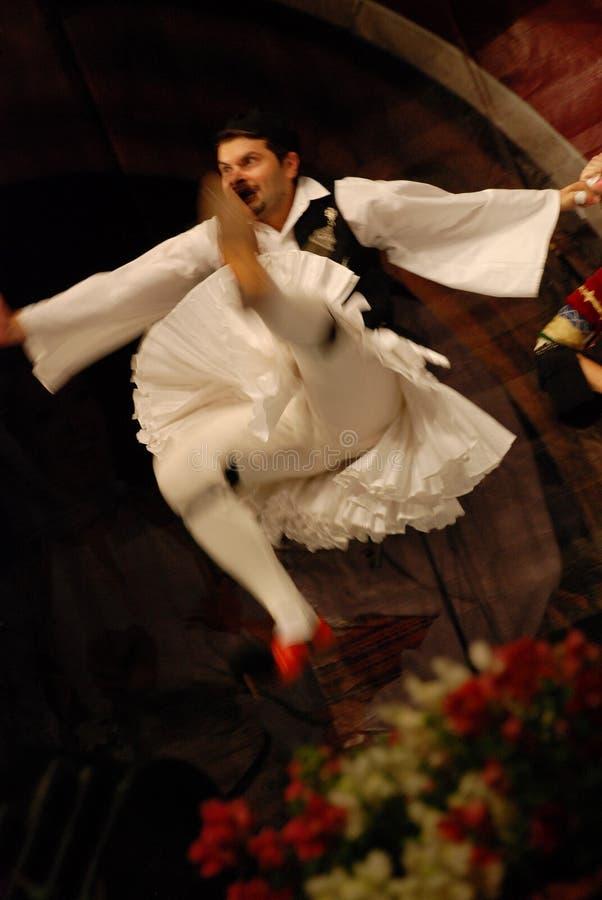 Greek folk dancer jumping on stage