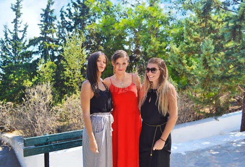 Greek girls at an Orthodox christening royalty free stock image
