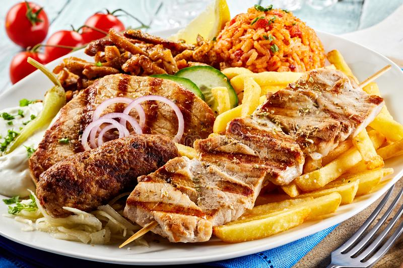 Greek grill plate with assorted meats stock photo